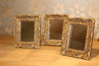 Baroka stila spogulīši zelta un kapara rāmī